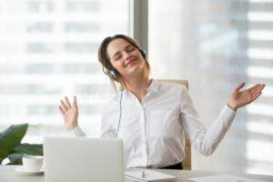 Happy Female Worker Enjoying Favorite Music Work Employee Wearing Headset Listening To Tracks Laptop Smiling Businesswoman 122984534